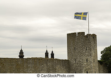 Town Wall in Visby, Gotland with the Swedish flag and the ...