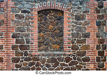 Town wall - The close-up of a town wall of different stones.