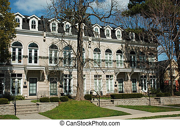 Townhomes - houses - A group of formal expensive townhouses...