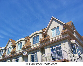 Townhomes - houses - A group of townhouses - homes with...