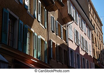 Buildings in an old urban street of Vevey, Switzerland, sunlight projecting shadows