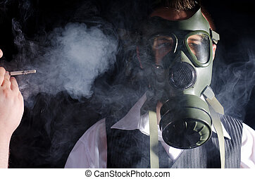 Toxic environment - Man wearing a gas mask for protection...