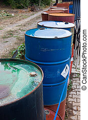 toxic waste - stacks of drum of chemical and inflammable ...
