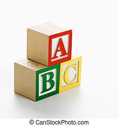 ABC alphabet blocks stacked together.