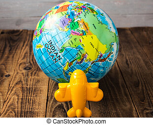 toy airplane and the globe