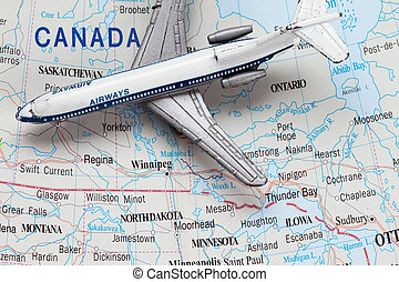 Toy Airplane on Map of Canada
