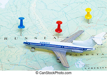 Toy Airplane on Map of Russia