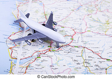 Toy airplane on the map