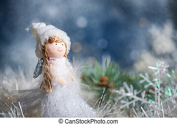 Toy angel and Christmas tree winter holiday festive background