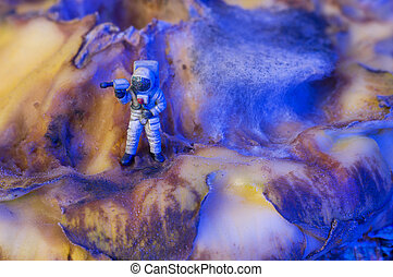 Toy astronaut on an alien planet