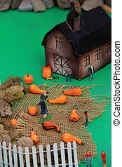 Toy barn and pumpkins
