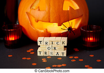 toy blocks with trick or treat words on halloween
