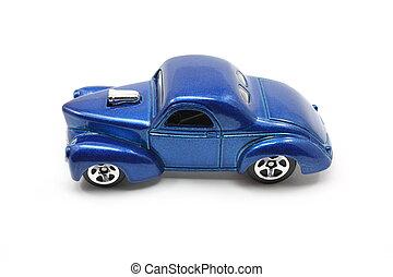 Toy Blue Drag Racing Car - Toy blue drag racing car on a...