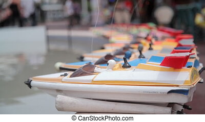 Toy boats on a fountain at a fair