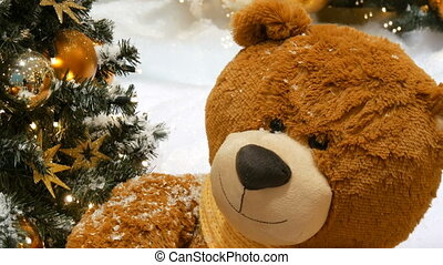 Toy brown bear as a decor near beautifully dressed Christmas...