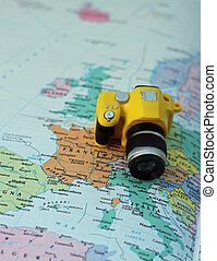 toy camera on the map of Europe and Italy