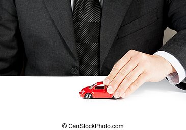 toy car and hand of business man, concept for insurance, ...