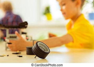 Selective focus of a toy car wheel