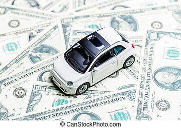 Toy car, dollar bills
