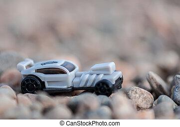 Toy car on gravel