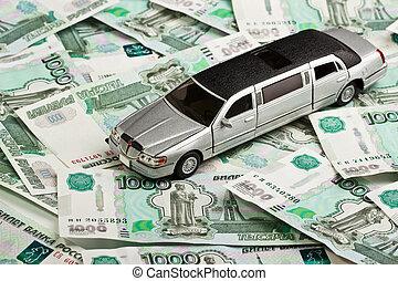 Toy car on money background