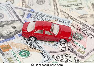 Toy car on money