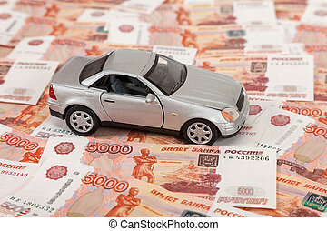 Toy car on the background of russian banknotes