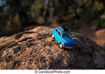Toy car on the rock