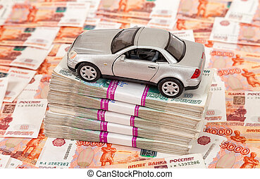 Toy car on the stack of rubles bills
