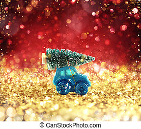 Toy car that transport a Christmas tree on a glowing gold...