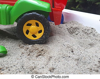 toy car wheel in the sand. Sand toys for children to play.