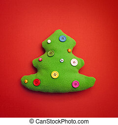 Toy Christmas Tree On Red Background