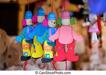 Toy clowns on sale at the market
