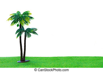 Toy coconut tree on grass with isolated white background