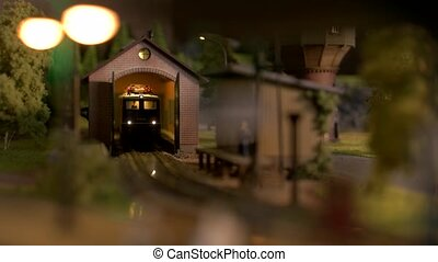 Toy diesel railway engine at depot station. Scale model railway layout with diesel locomotive.