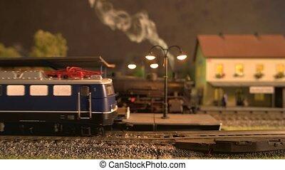 Toy diesel train on model railway station.