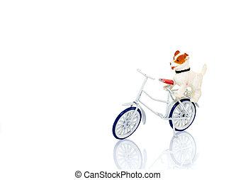toy dog on white bike