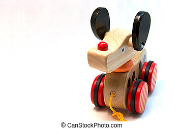 Toy dog - A child's wooden toy dog isolated on white