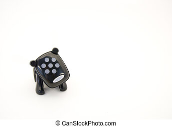Toy dog - Little black plastic toy dog isolated against a...