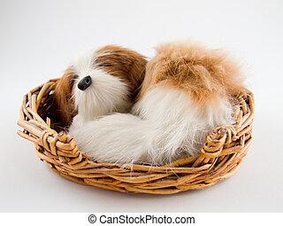 Toy Dog - a toy dog a sleep in a straw basket