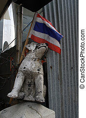 Toy dog ??with a flag next to the dressing