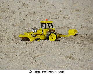 Toy  dozer  - Yellow toy  dozer  in sand