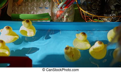 toy ducks floating on the water.
