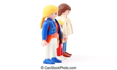 Toy family is located on a rotating stand, front view