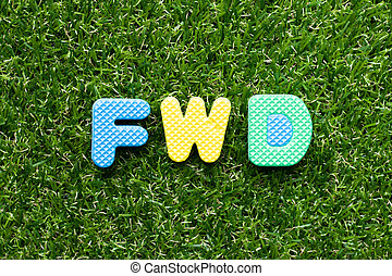 Toy foam letter in word FWD (Abbreviation of forward) on green grass background