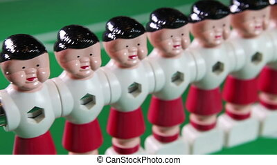 toy football players stand in a row