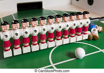 toy football players stand on the football field, several...