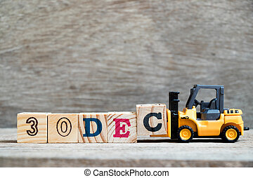 Toy forklift hold block c to complete word 30dec on wood background (Concept for calendar date 30 in month December)