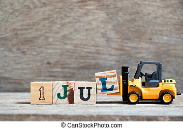 Toy forklift hold block l to complete word 1 jul on wood background (Concept for calendar date in month July)