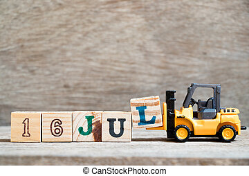 Toy forklift hold block l to complete word 16 jul on wood background (Concept for calendar date in month July)